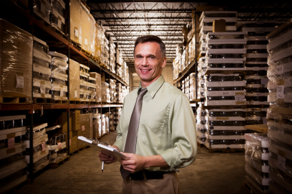 Successful Businessman in Warehouse